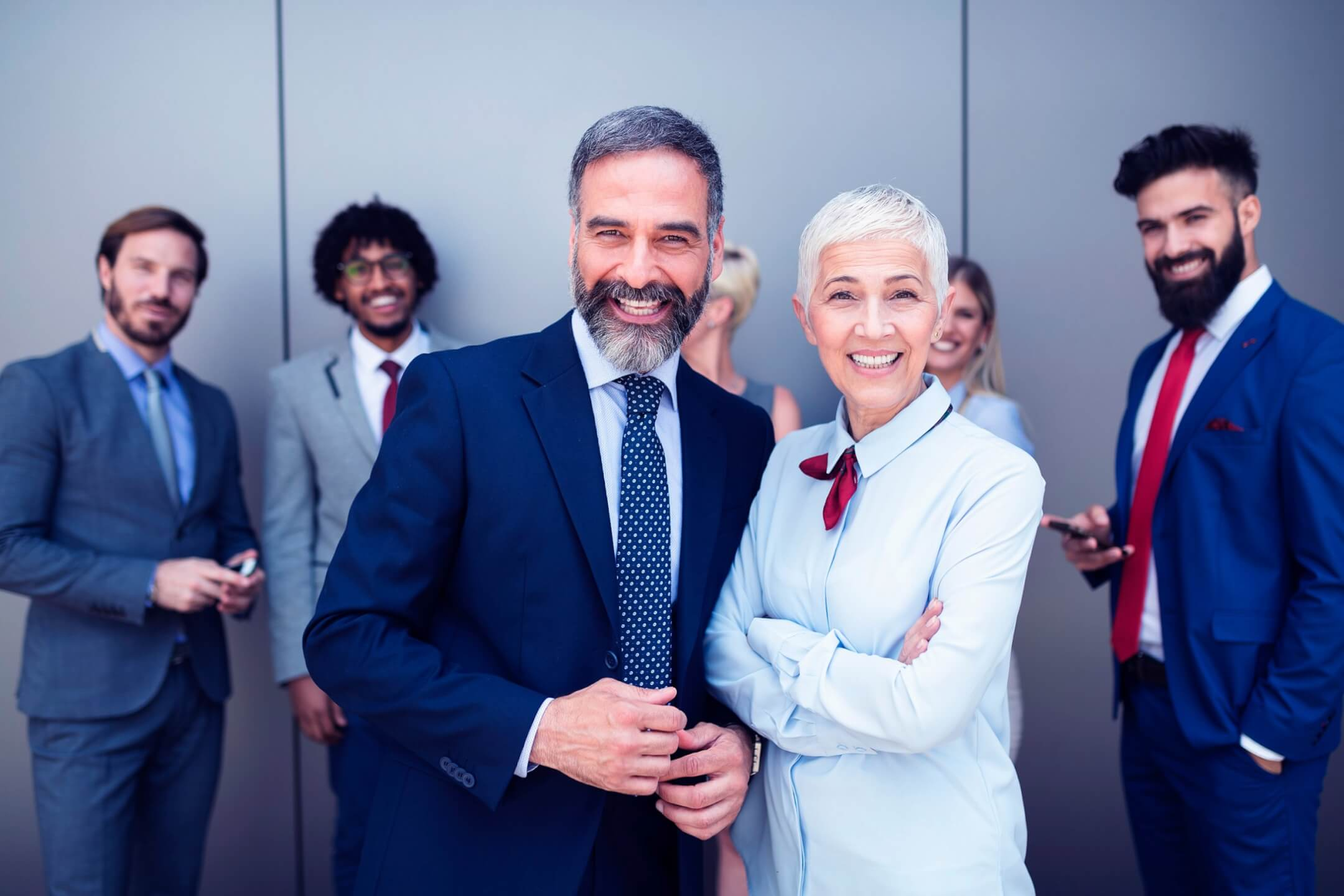 portrait-of-businesspeople-standing-with-arms-7LWEQFP-scaled.jpg